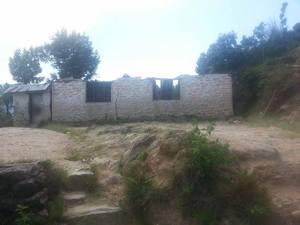 eines der zerstörten Gebäude
